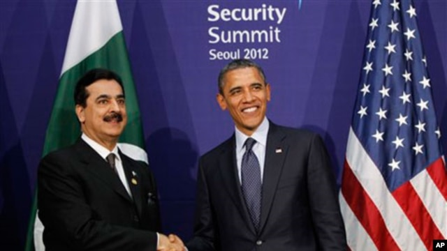 Pakistani Prime Minister Syed Yusuf Raza Gilani, left, and U.S. President Barack Obama smile during their bilateral meeting on the sidelines of the Nuclear Security Summit in Seoul, March 27, 2012.