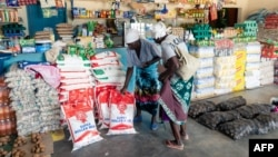 FILE: Two elderly women shop for mealie meal and other basic commodities, March 14 2019, in the Mutoko rural area of Zimbabwe. Eastern Zimbabwe receives help to fight drought induced hunger.