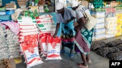 FILE: Two elderly women shop for mealie meal and other basic commodities, March 14 2019.