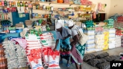 Two elderly women shop for mealie meal and other basic commodities, March 14 2019, in the Mutoko rural area of Zimbabwe. Eastern Zimbabwe receives help to fight drought induced hunger.