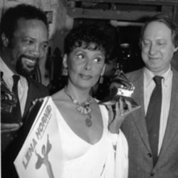 Grammy Award winner Lena Horne poses with record producer Quincy Jonesand Dan Morgenstern of the National Academy of Recording Arts and Sciences