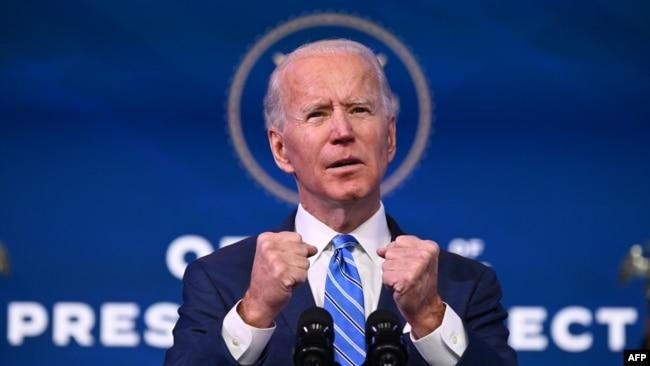 Tổng Thống tân cử Joe Biden loan báo kế hoạch kích thích kinh tế và kiềm chế đại dịch tại Hí viện Queen ở Wilmington, bang Delaware, Hoa Kỳ, ngày 14/1/2021. (Photo by JIM WATSON / AFP)