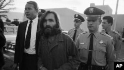 "FILE - Charles Manson, leader of a hippie cult accused of multiple murders, leaves a Los Angeles courtroom, Dec. 22, 1969, after telling a judge ""lies have been told"" about him."