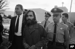 "Charles Manson leaves a Los Angeles courtroom, Dec. 22, 1969 after telling a judge ""lies have been told"" about him."