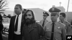 "FILE - Charles M. Manson, leader of a hippie cult accused of multiple murders, leaves a Los Angeles courtroom, Dec. 22, 1969 after telling a judge ""lies have been told"" about him."