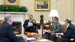 President Obama receives a briefing on the earthquake in Japan and the tsunami warnings across the Pacific, in the Oval Office of the White House, March 11, 2011