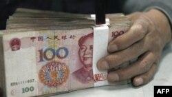 Trung Quốc sẵn sáng tiến hành các biện pháp làm cho đồng nhân dân tệ trở thành một chỉ tệ quốc tế hàng đầu giống như đồng đôla Mỹ và đồng euro