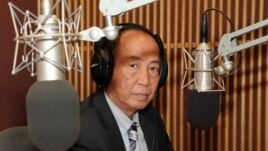 Mam Sonando, the owner of Beehive Radio FM 105 in Cambodia, visited Voice of America headquarters in Washington, D.C on Monday May 27, 2013. Here, he is participating in the Khmer Service's 'Hello VOA' radio call-in program. (Im Sothearith / VOA Khmer)