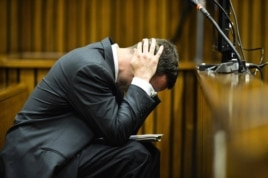 Oscar Pistorius cradles his head in his hands in court on the fifth day of his trial at the high court in Pretoria, South Africa, March 7, 2014.