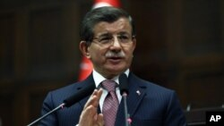 Turkish Prime Minister Ahmet Davutoglu addresses lawmakers in Ankara, Jan. 26, 2016. He has reiterated Turkey's opposition to including Syrian Kurdish forces at the Geneva talks.