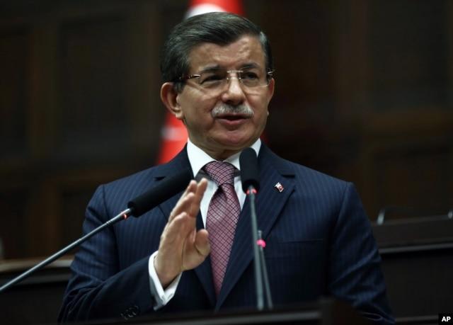 FILE - Turkish Prime Minister Ahmet Davutoglu addresses lawmakers in Ankara, Jan. 26, 2016.