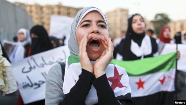 Women take part in a demonstration against Syria's President Bashar al-Assad, May 31, 2012.
