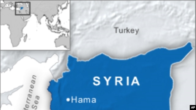 Tanks Surround Flashpoint Syrian City, Residents Flee