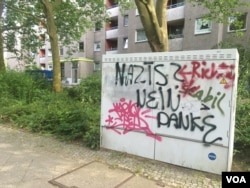 """""""Nazis? No thanks"""" reads the graffiti on this wall in Berlin. The rising far right in Germany has provoked fears from the left, further polarizing the country, July 8, 2016. (Photo: H. Murdock / VOA)"""
