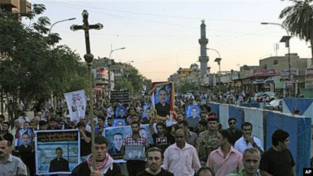 Muslims and Christians chant anti-terrorist slogans during a funeral of slain Christians in Baghdad, Iraq, 02 Nov 2010