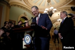 Senate Minority Leader Chuck Schumer, accompanied by Sen. Dick Durbin (D-IL) and Sen. Patty Murray (D-WA), speaks with reporters following the party luncheons on Capitol Hill in Washington, Jan. 23, 2018.