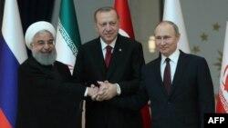 Les présidents iranien Hassan Rohani, turc Recep Tayyip Erdogan et russe Vladimir Poutine à Ankara, le 4 avril 2018.
