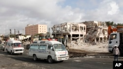 Ambulances carrying wounded victims pass the scene of Saturday's truck bomb blast, as they head to the airport for victims to be airlifted for treatment in Turkey, in Mogadishu, Somalia, Oct, 16, 2017