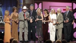 "Cast members of ""Dallas"" accept the pop culture award at the TV Land awards show in 2006 in Santa Monica, California. The awards honor classic shows and performers. From left: Charlene Tilton, Linda Gray, Larry Hagman, Patrick Duffy, Sheree Wilson, Mary C"