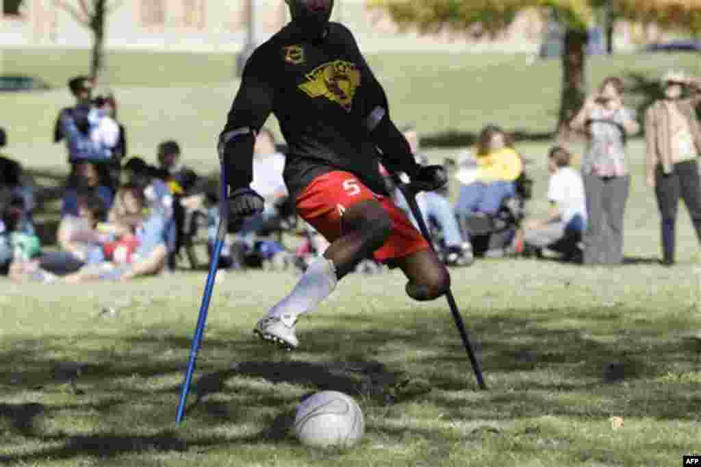 Francois MacKendy, a members of the Haitian National Amputee Soccer Team, plays in an exhibition match on the grounds of the Texas state capitol, Tuesday, Nov. 16, 2010 in Austin, Texas. The team is touring throughout the country to raise support for ampu