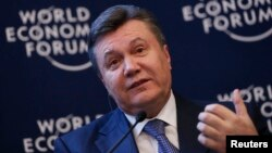 FILE - Ukraine's President Viktor Yanukovich addresses delegates during the annual meeting of World Economic Forum in Davos, Switzerland, Jan. 24, 2013.