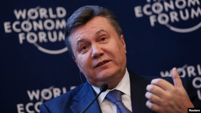 Ukraine's President Viktor Yanukovich addresses delegates during the World Economic Forum in Davos, Switzerland, Jan. 24, 2013.