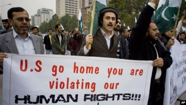 Members of a Pakistani civil society chant slogans during anti-U.S. rally, Islamabad, Feb. 28, 2011.