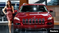 FILE - A Jeep Cherokee on display at an auto show.