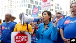 U.S. Congresswoman Judy Chu (D-Calif.) joins U.S. Post Office employees during a protest, April 24, 2014, in downtown Los Angeles.