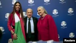 President of Italian Golf Federation Franco Chimenti (center) poses with Italian designer Laura Biagiotti (right) and her daughter, Lavinia, in Rome, Dec. 16, 2015.