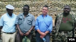 FILE - Ambassador Bruce Wharton at Naletale National Monument with Gweru mayor Hamutendi Kombayi (left) and Norbert Nhutsve (right), regional director of National Museums and Monuments of Zimbabwe. (Photo/Taurai Shava)