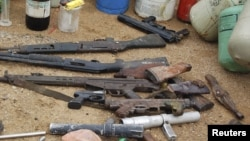 Confiscated weapons are displayed after a military raid on a hideout of suspected Islamist Boko Haram members in Nigeria's northern city of Kano, August 11, 2012.
