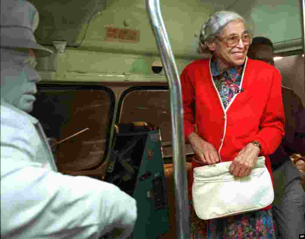 FILE - Rosa Parks visits an exhibit illustrating her bus ride of December, 1955 at the National Civil Rights Museum in Memphis, Tennessee, July 15, 1995.