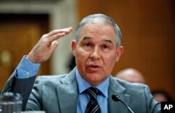 FILE - Environmental Protection Agency administrator Scott Pruitt testifies before the Senate Environment Committee on Capitol Hill in Washington, Jan. 30, 2018.