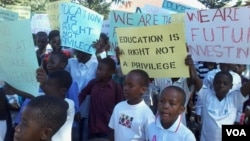 FILE: Some of the children and parents who staged protests over school fees seen recently in Harare. (Photo: Irwin Chifera)