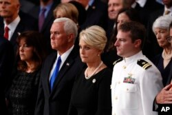 Cindy McCain, center, stands with Vice President Mike Pence and Jack McCain, right, during a ceremony as the casket of Sen. John McCain lies in state at the Rotunda of the U.S. Capitol in Washington, Aug. 31, 2018.