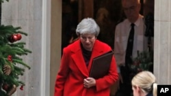 Britain's Prime Minister Theresa May leaves 10 Downing Street to make a statement in Parliament in London, Dec. 3, 2018.