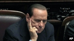 Italy's Prime Minister Silvio Berlusconi attends a debate at the Parliament in Rome October 13, 2011
