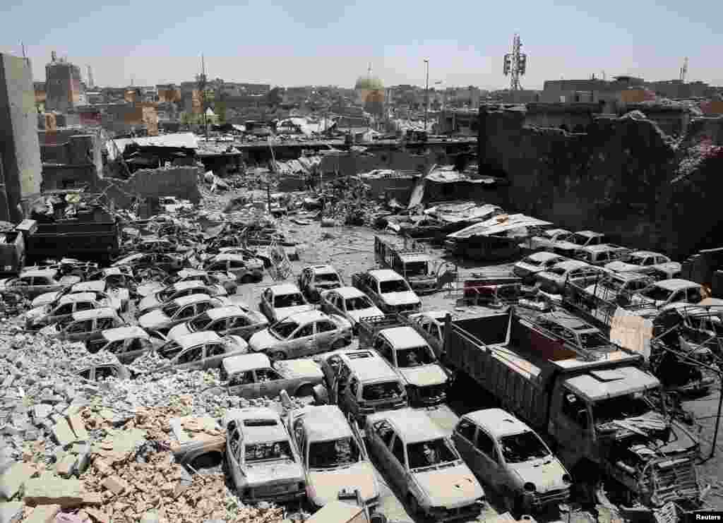 A destroyed al-Hadba minaret at Grand al-Nuri Mosque (L) is seen in Mosul, Iraq.