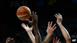 FILE - United States' and Serbia's players go for the ball during the final World Basketball match at the Palacio de los Deportes stadium in Madrid, Spain, Sept. 14, 2014. The women's basketball World Cup will be held Sept. 22-30, 2018, in Spain.