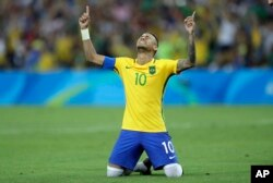 Brazil's Neymar cries as he celebrates after scoring the decisive penalty kick during the final match of the men's Olympic football tournament between Brazil and Germany at the Maracana stadium in Rio de Janeiro, Aug. 20, 2016.