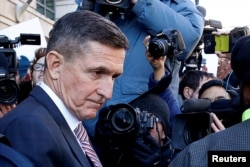 Former U.S. national security adviser Michael Flynn passes by members of the media as he departs after his sentencing was delayed at U.S. District Court in Washington, U.S., Dec. 18, 2018.