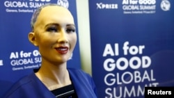 "Sophia, a robot displayed at a technology conference in Riyadh, Saudi Arabia, last week, is seen during a presentation at the ""AI for Good"" Global Summit in Geneva, Switzerland, June 7, 2017."