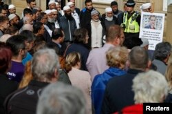 People gather during a vigil for Labour Member of Parliament Jo Cox, in Batley near Leeds, in Britain, June 17, 2016.