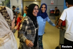 Hanadi Al-Hai, right, welcomes her mother traveling from Jordan on a Yemeni passport following the reinstatement by the U.S. Supreme Court of portions of President Donald Trump's executive order targeting travelers from six predominantly Muslim countries in Los Angeles, California, June 29, 2017.