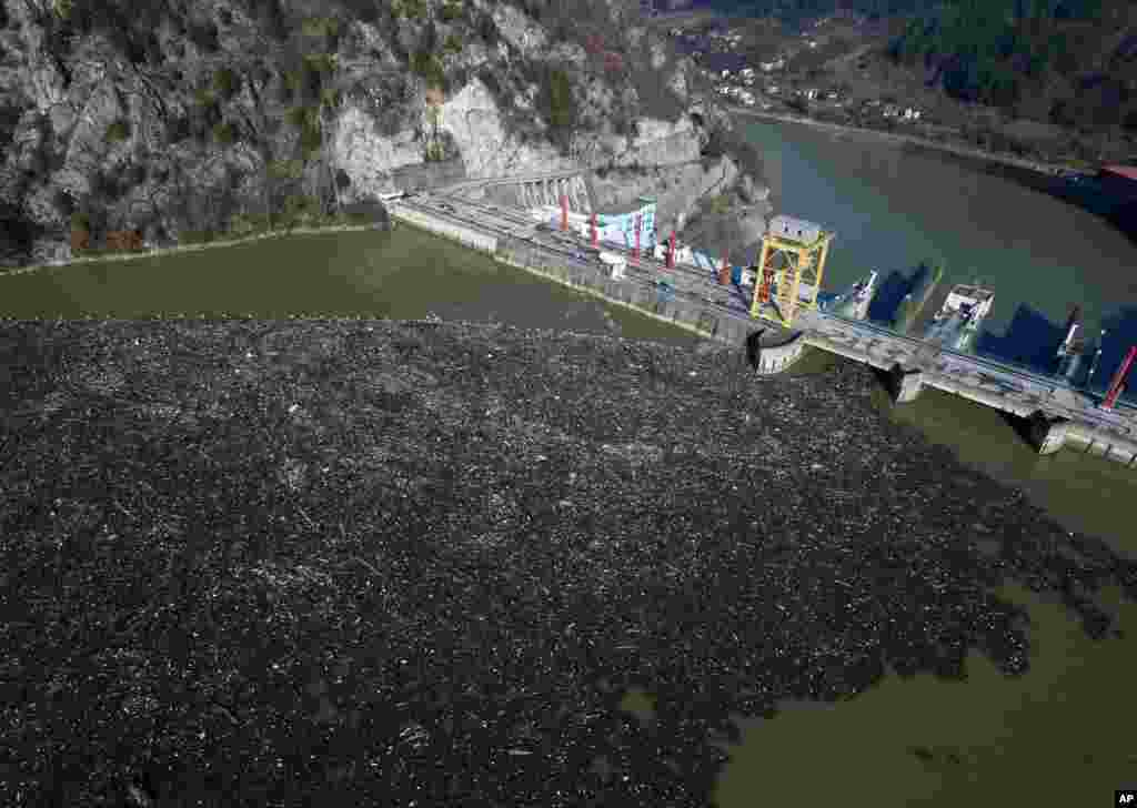 This is aerial photo shows plastic bottles, wooden planks, rusty barrels and other garbage clogging the Drina river near the eastern Bosnian town of Visegrad, Bosnia.