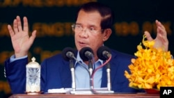 In this file photo taken on March 22, 2019, Cambodia's Prime Minister Hun Sen delivers a speech during a groundbreaking ceremony to build the country's first expressway, in Kampong Speu province, south of Phnom Penh, Cambodia.