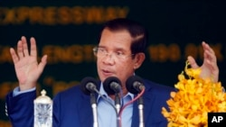 FILE: Cambodia's Prime Minister Hun Sen delivers a speech during a groundbreaking ceremony to build the country's first expressway, in Kampong Speu province, south of Phnom Penh, Cambodia, Friday, March 22, 2019.