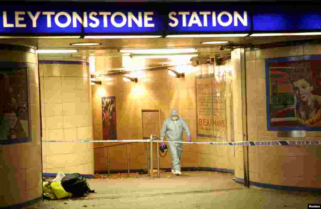 Police officers investigate a crime scene at Leytonstone underground station in east London, Britain. Police were called to reports of a number of people stabbed at the station in east London and a man threatening other people with a knife. One man was seriously injured and two sustained minor injuries, police said.