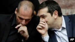 Grčki ministar finansija Janis Varufakis i premijer Aleksis Cipras